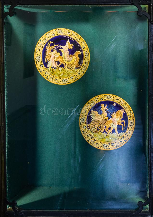 Commemorative medals in a glass niche set for general view in the Clock Tower to the old city. Sighisoara city in Romania. Sighisoara, Romania, October 08, 2017 stock images