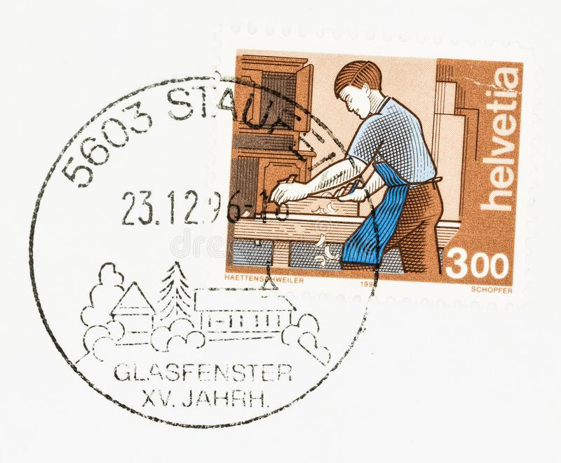 Commemorative Postmark on envelope and stamp. SEATTLE, WASHINGTON - JUNE 4, 2019: 3 Swiss Franc postage stamp was issued in 1994 as part of the Occupations royalty free stock photos