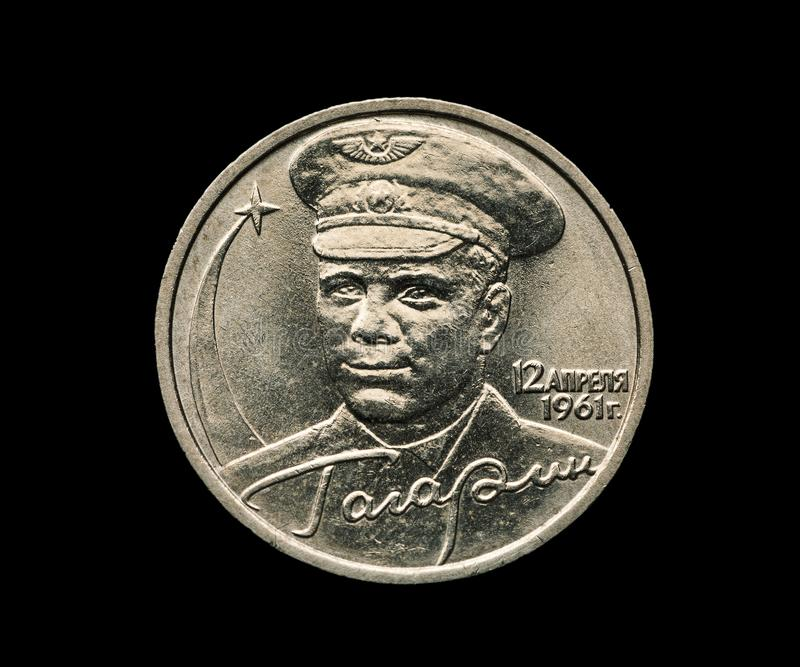 Commemorative russian coin with Yuri Gagarin portrait isolated on black. 12 of april 1961, USSR, cosmonaut, numismatics, collection, space, astronaut royalty free stock photography