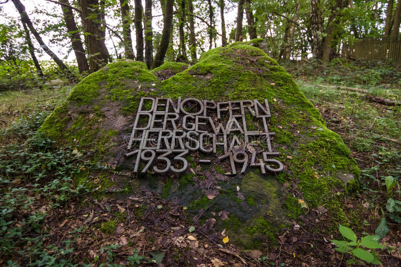 A commemorative sign in front of an old and abandoned Jewish cemetery. royalty free stock images