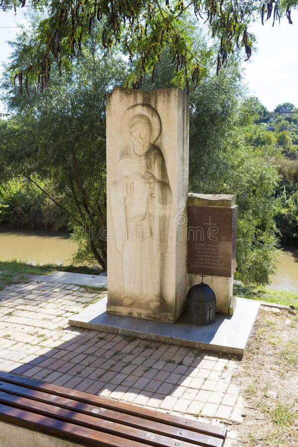 Commemorative slab and the Lom river at Rock Monastery St. Dimitar Basarabovski. Near Ruce city in Bulgaria royalty free stock image