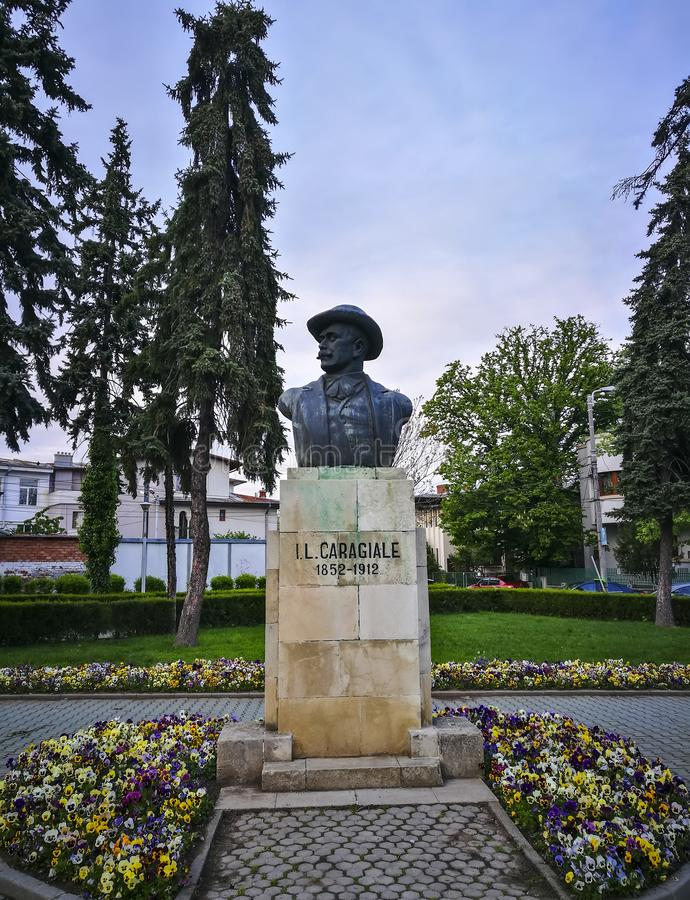 Ion Luca Caragiale Statue in Ploiesti , Romania. The commemorative statue of one of the greatest drama player writer in Romanian culture , Ion Luca Caragiale in stock photo