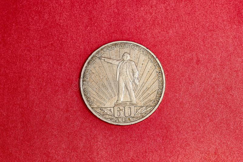 Commemorative USSR coin one ruble in memory of 60th anniversary of the October revolution. Commemorative USSR coin one ruble dedicated to 60th anniversary of the royalty free stock image