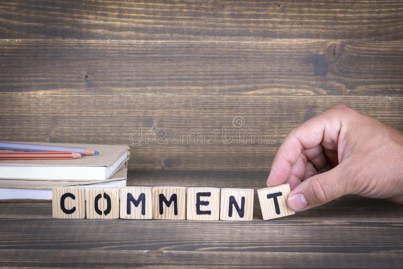 Comment. wooden letters on the office desk royalty free stock photo