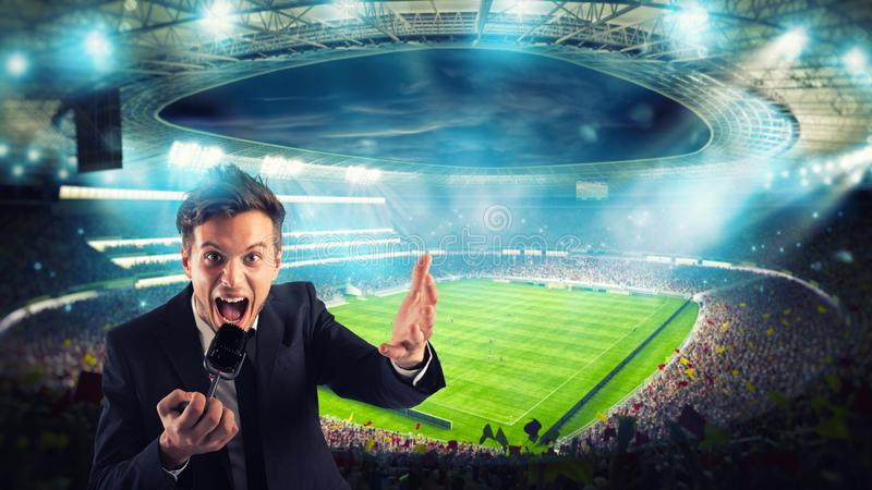 Sports journalist comments on a football match at the stadium stock image
