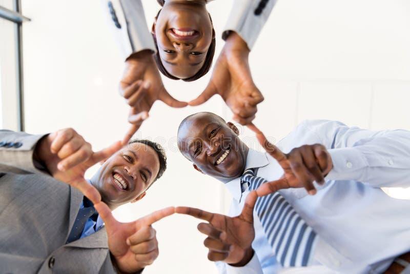 Commerciële groeps verbindende handen stock foto's