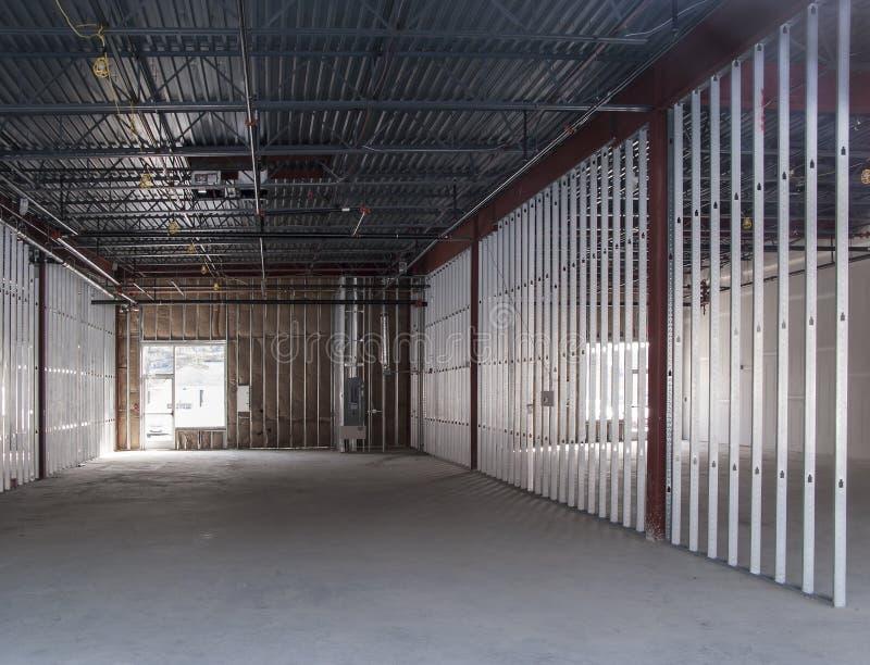 Commerciële ruimte in aanbouw stock afbeeldingen