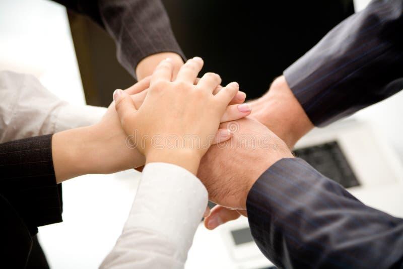 Commerciële team toetredende handen royalty-vrije stock foto's