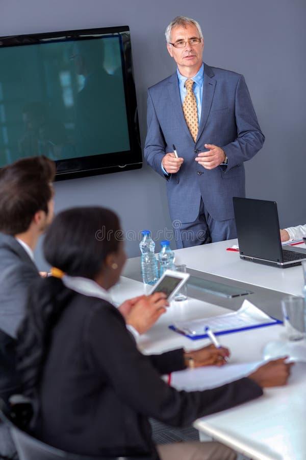 Commerciële van de managergreep vergadering stock fotografie