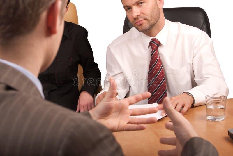 Commerciële vergadering - lichaamslangua stock foto