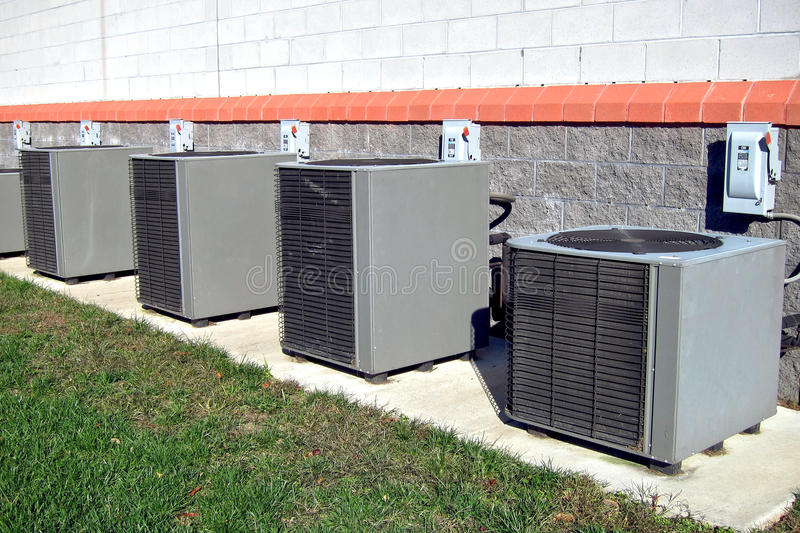 Commercial Air Conditioner Condenser AC Units Row royalty free stock images
