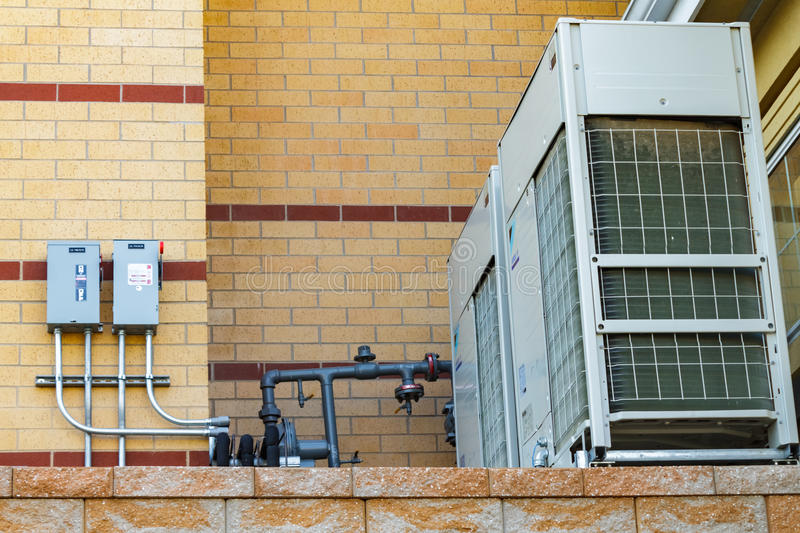 Commercial air conditioning unit. With brick background stock photography