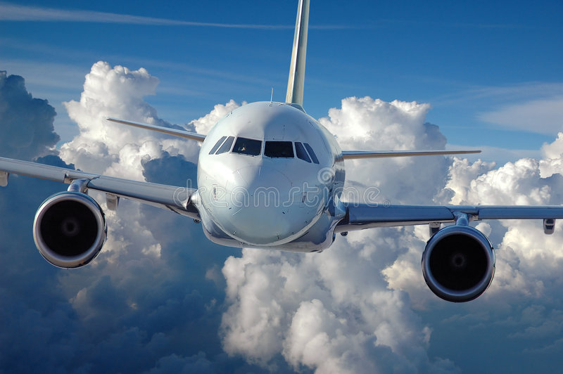 Commercial Airliner in Flight stock photos