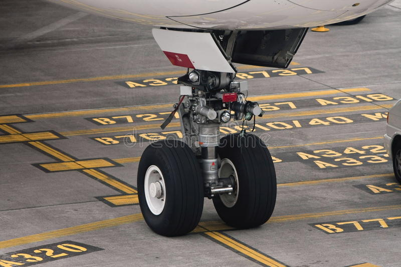 Download Commercial Airliner Undercarriage On Tarmac Stock Photo - Image: 25513428