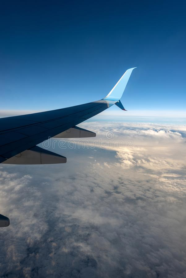 Commercial Airplane - Flying Above The Clouds Stock Image ...