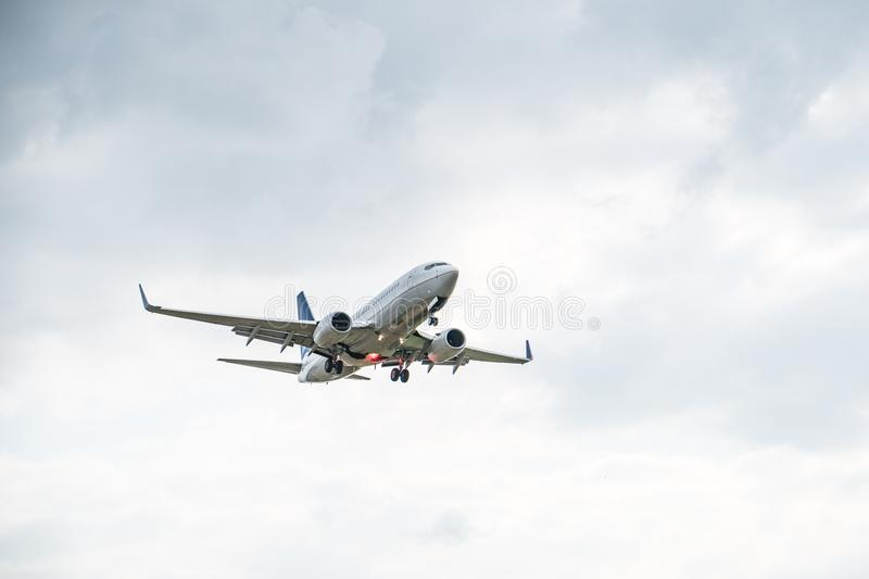 Commercial airplane on sky - passenger aircraft - stock images