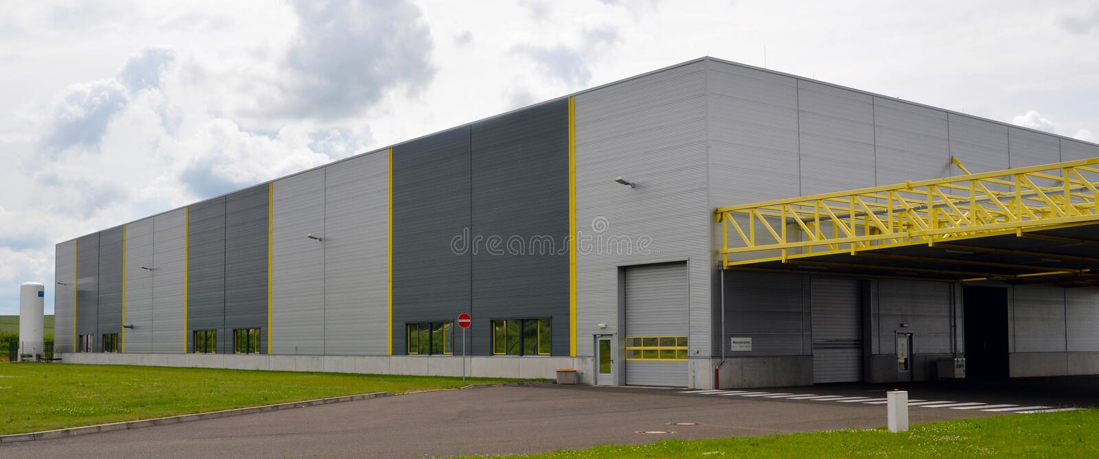 Commercial building exterior view of a mechanical engineering fa. Ctory outside royalty free stock image
