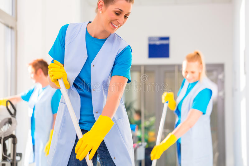 Commercial cleaning brigade working stock photography