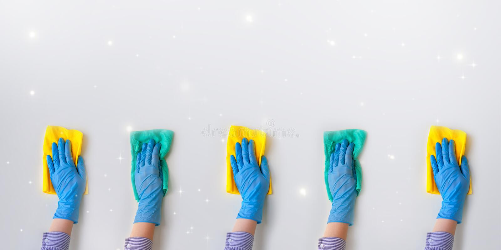 Commercial cleaning company. Employee hands in blue rubber protective glove. General or regular cleanup royalty free stock photography