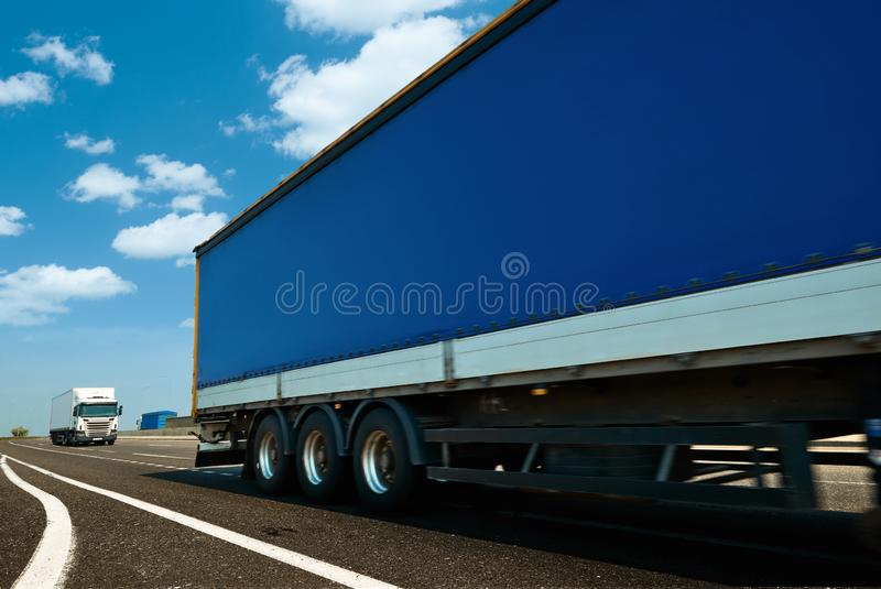 Commercial delivery cargo truck on highway traffic royalty free stock image