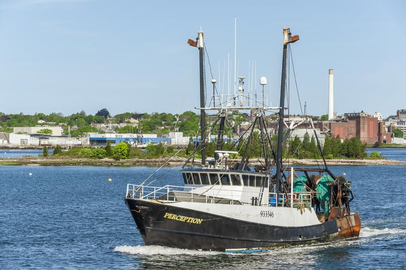 Commercial fishing boat Perception leaving New Bedford, Massachusetts. New Bedford, Massachusetts, USA - May 25, 2019: Trawler Perception heading out of New stock photos