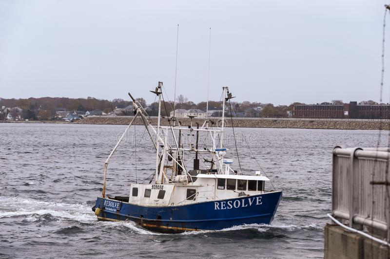 Commercial fishing boat Resolve transiting New Bedford hurricane barrier. New Bedford, Massachusetts, USA - November 12, 2019: Commercial fishing boat Resolve stock photography
