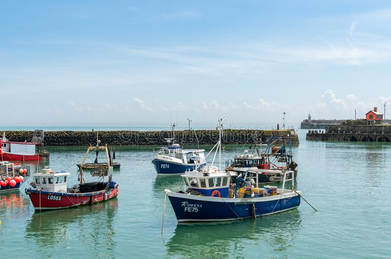 Commercial fishing trawlers at Folkestone Harbour. Opened in 1807, Folkestone Harbour is the main harbour of the town of Folkestone in Kent, England stock photography