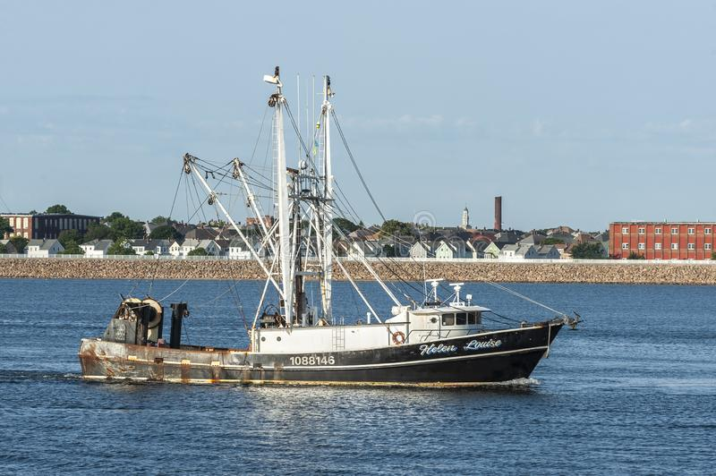 Commercial fishing vessel Helen Louise nearing New Bedford. New Bedford, Massachusetts, USA - August 2, 2019: Trawler Helen Louise, hailing port Aurora, North stock images
