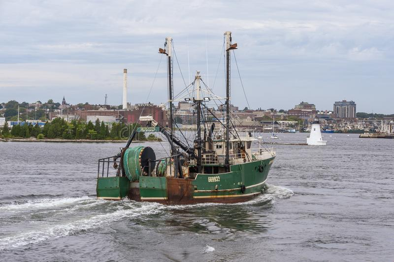 Commercial fishing vessel Hercules returning to port stock photo