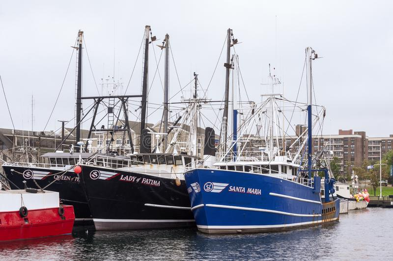 Commercial fishing vessels Queen of Peace, Lady of Fatima and Santa Maria in port. New Bedford, Massachusetts, USA - October 12, 2019: Commercial fishing boats royalty free stock image