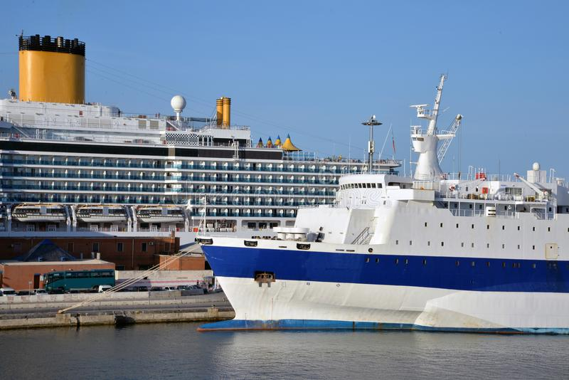 Commercial harbor, modern cruise ship and old ferry stock images