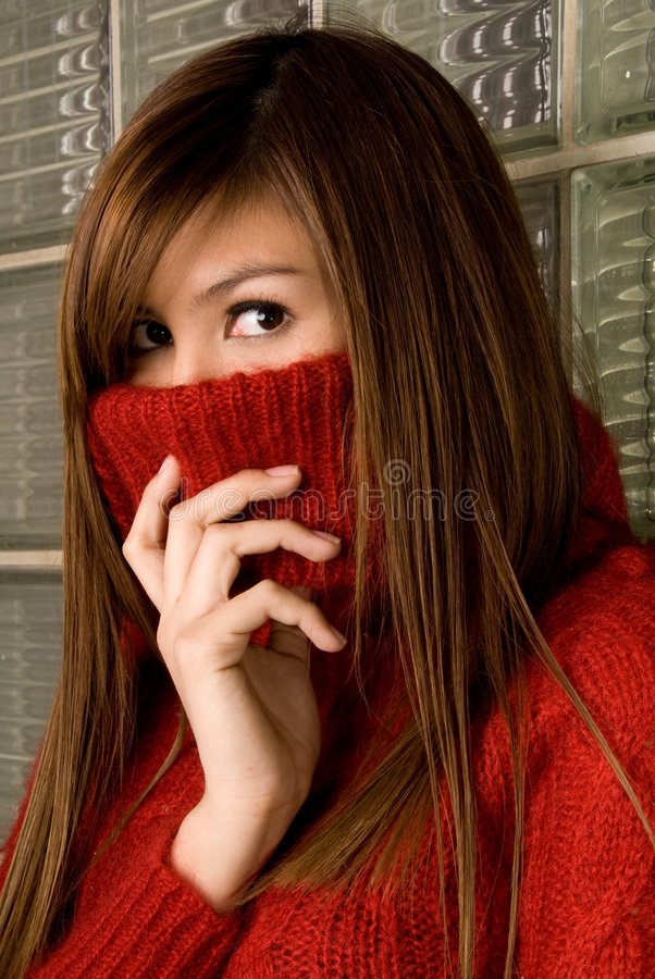 Commercial head shot shot- Fashion Series. Fashion shot of model covering her mouth with turtleneck only exposing her eyes and bridge of nose stock photos