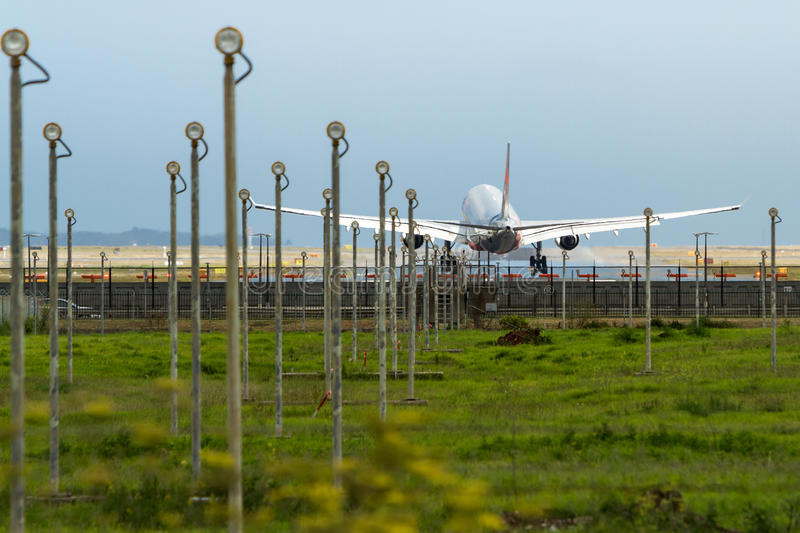 Download Commercial Jet Airliner Landing At Airport Stock Photography - Image: 36687012