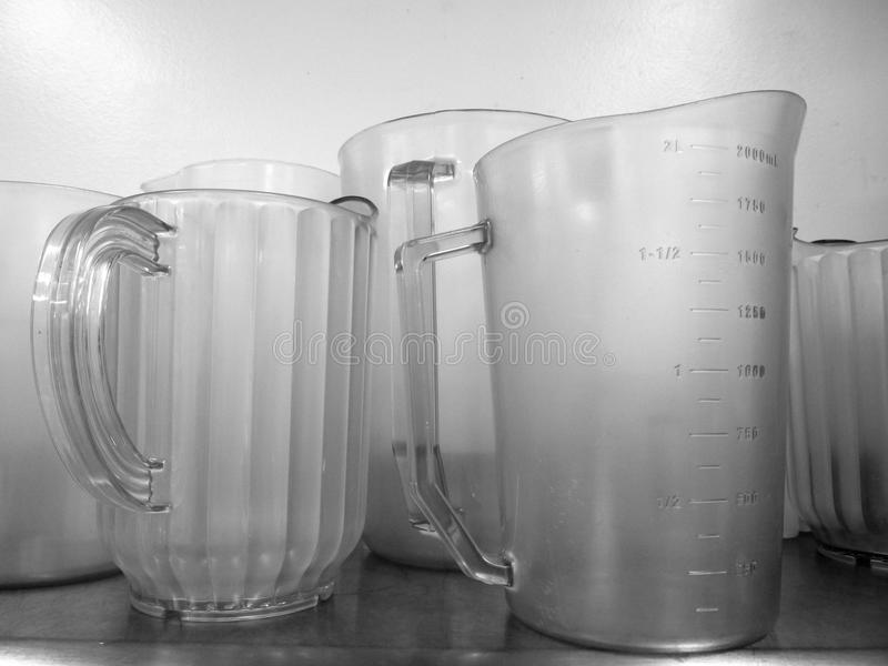 Commercial kitchen: measuring jugs. Commercial kitchen with measuring jugs - black and white stock photo