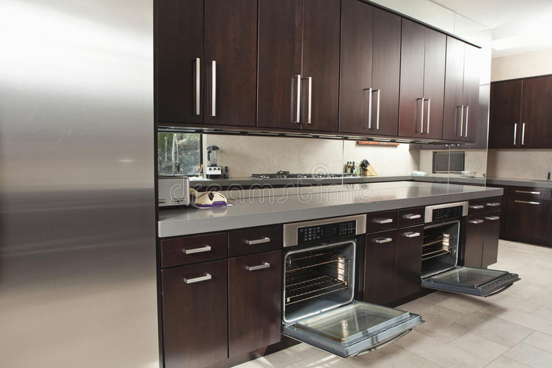 Open Kitchen Oven ~ Commercial kitchen with open oven and cabinets stock photo