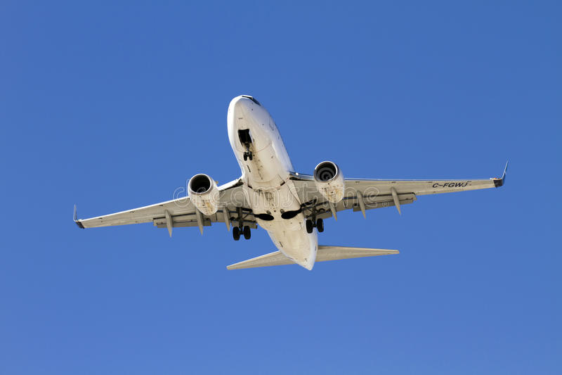 Commercial Passenger Jet Landing. Commercial passenger jet approaches Sky Harbor Airport in Phoenix, AZ, USA, for landing. The Sky Harbor Airport completed stock image
