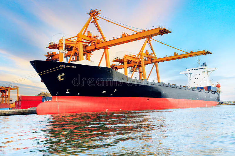Commercial ship loading container in shipping port image use for royalty free stock images