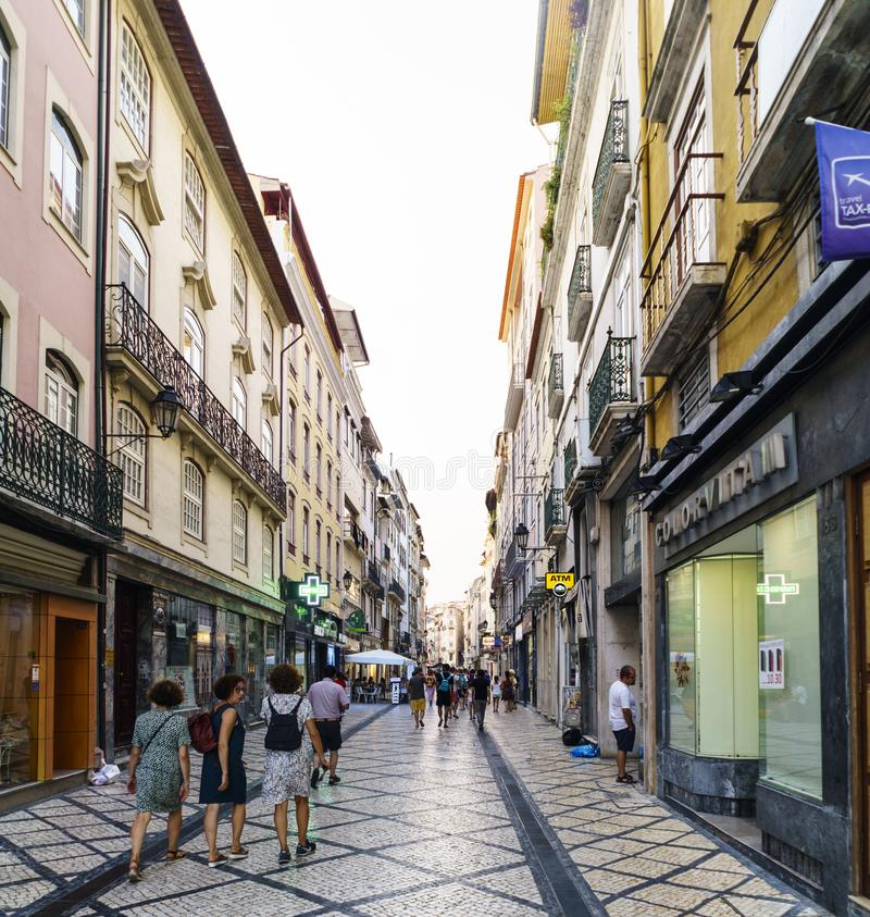 Commercial street full of shops in the historic center with many people walking and buying stock image