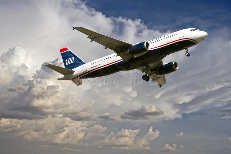 Commercial Travel Passenger Jet Landing. Commercial passenger jet approaches Sky Harbor Airport in Phoenix, AZ, USA, for landing. The Sky Harbor Airport royalty free stock photography