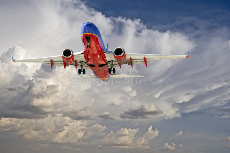 Commercial Travel Passenger Jet Landing. Commercial passenger jet approaches Sky Harbor Airport in Phoenix, AZ, USA, for landing. The Sky Harbor Airport stock image