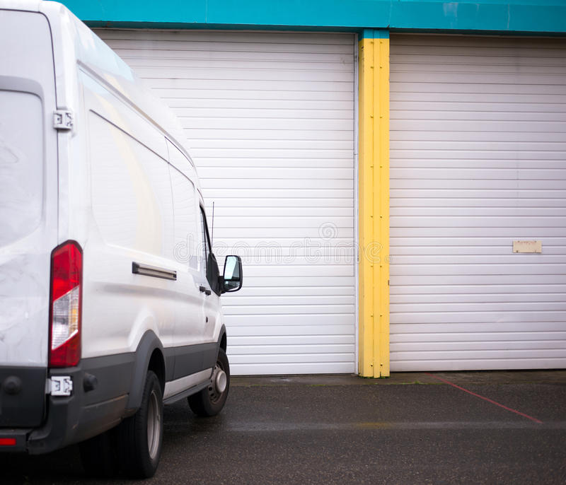 Commercial van for transporting cargo waiting by the warehouse g stock photo