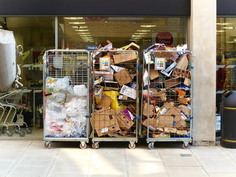 Commercial waste collected outside a supermarket. Views, life and commercial waste collected outside a supermarket in wire mesh baskets stock photography