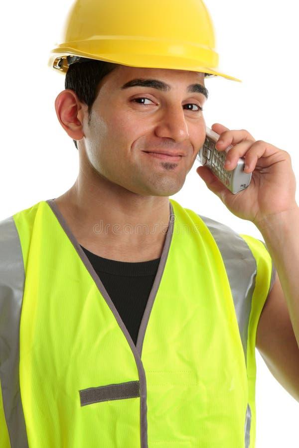 Commerciante del costruttore sul telefono fotografia stock libera da diritti