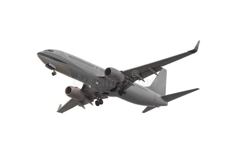 Commercieel die vliegtuig op witte achtergrond met het knippen van p wordt geïsoleerd stock fotografie