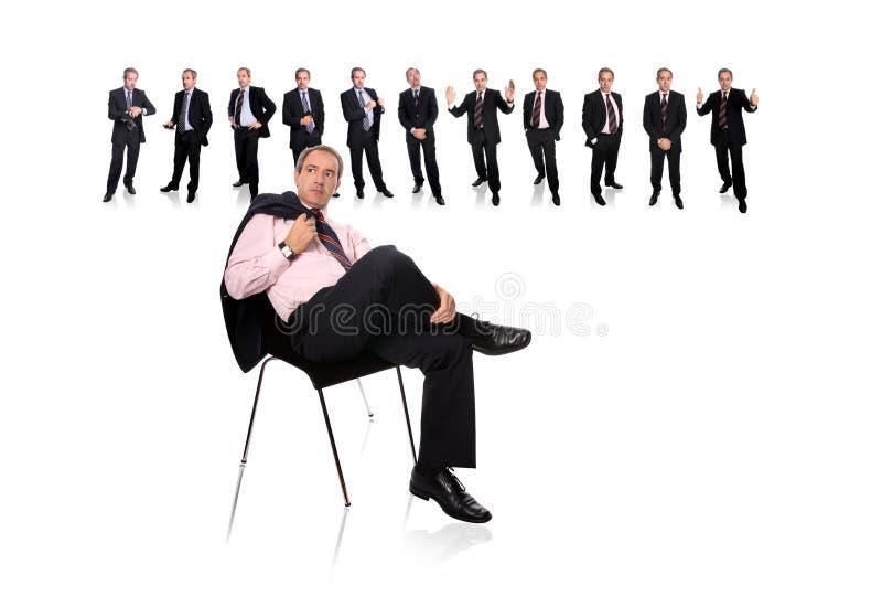 Commercieel mens en personeel erachter royalty-vrije stock fotografie
