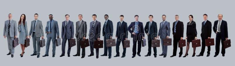 Commercieel team met hun aktentas in één enkele lijn tegen wh royalty-vrije stock foto
