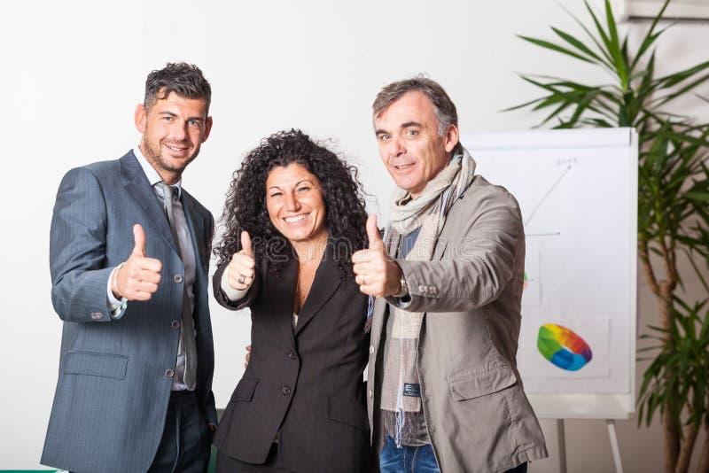 Commercieel Team met omhoog Thums royalty-vrije stock afbeelding