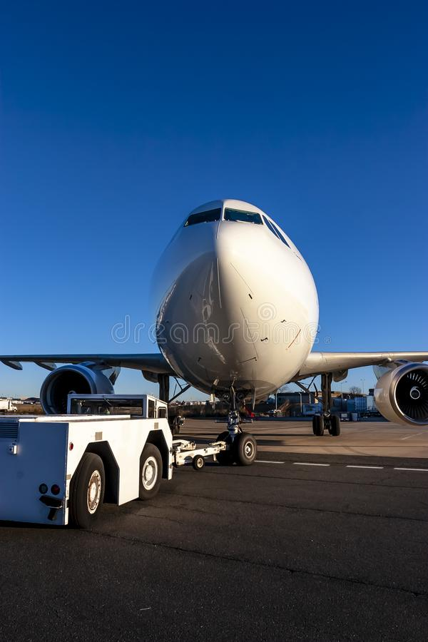 Commerical Cargo Aircraft On The Tarmac Of An International Airport. A commercial cargo aircraft sits on a tarmac at an international airport royalty free stock image