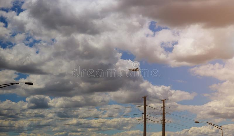 Commerical passenger jet coming on landing airport. Commerical passenger jet coming of commercial airliner landing airport airplane sky travel blue royalty free stock photo