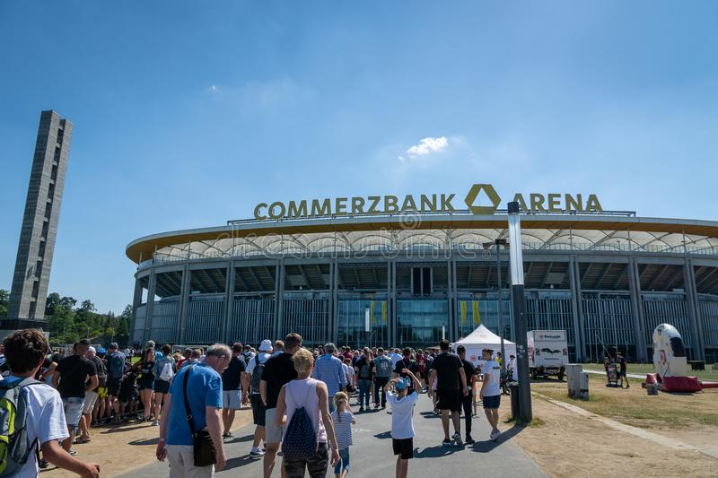 Commerzbank Arena and football fans - home stadium of football club Eintracht Frankfurt. Frankfurt, Germany- July 2019: View of Commerzbank Arena and football stock photography